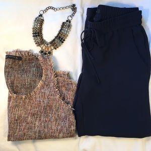 Deep navy blue elastic dress pants.